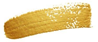 Guld- slaglängd för färgmålarfärgborste Guld- suddfläck för akryl på vit bakgrund Abstrakt begrepp specificerad guld som blänker  Arkivfoto