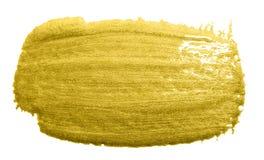 Guld- slaglängd för färgmålarfärgborste Guld- suddfläck för akryl på vit bakgrund Abstrakt begrepp specificerad guld som blänker  Arkivbild