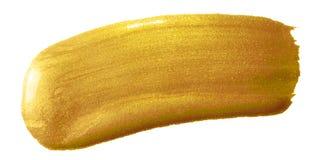 Guld- slaglängd för sudd för målarfärgborste Guld- färgfläck för akryl på vit bakgrund Abstrakt guld som blänker texturerad glans Fotografering för Bildbyråer