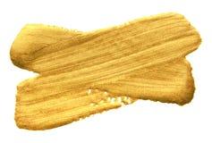 Guld- slaglängd för sudd för målarfärgborste Korsad guld- färgfläck på vit bakgrund Abstrakt guld som blänker texturerad glansig  Royaltyfri Fotografi
