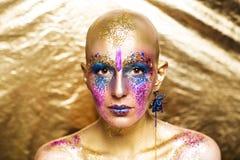Guld- smink arkivfoto