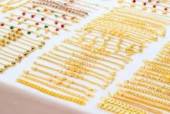 Guld- smycken Arkivfoton
