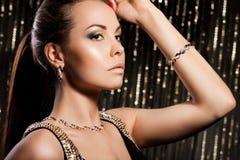 guld- smyckenkvinna Arkivbild