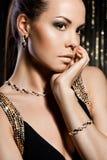 guld- smyckenkvinna Arkivfoton
