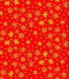Guld- snöflingor på rött Arkivbilder