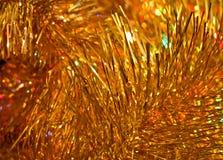 Guld- softabstrakt begreppbakgrund Arkivfoto