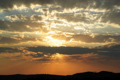 guld- solnedgång Arkivfoton