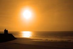 guld- solnedgång för ballybunionstrand Arkivfoto