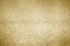 Guld som blänker julljus suddighet abstrakt bakgrund royaltyfri foto