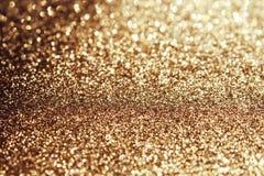 Guld- sparkling bakgrund royaltyfri fotografi