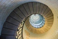 Guld- spiral i en trappa phare fotografering för bildbyråer