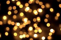 Guld spots bokehbakgrund Arkivbild