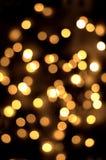 Guld spots bokehbakgrund Arkivbilder