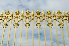 Guld- staket med visare Arkivbild