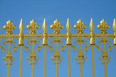 Guld- staket med visare och prydnader Royaltyfria Bilder