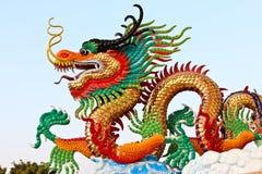 guld- staty för drake Arkivbilder