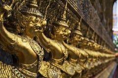 guld- statyer Arkivfoto