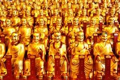 Guld- statyer av Lohansen royaltyfri bild