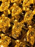 guld- statyer för array Royaltyfri Bild
