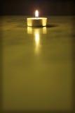 Guld- stearinljus Arkivfoto