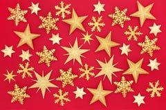 Guld- stjärnabakgrund för jul royaltyfri foto