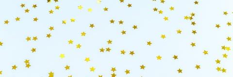 Guld- stjärnastänk på blått festlig ferie för bakgrund celeb Arkivbilder