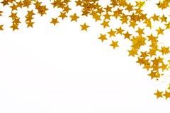 guld- stjärnor för julkonfettigarnering Royaltyfria Foton