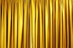 guld- stor etapp för gardin Arkivfoto