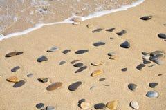 guld- strand Arkivfoton