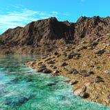 Guld- strand, seascape, stenig strand Arkivbild