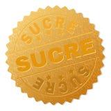 Guld- SUCRE emblemstämpel royaltyfri illustrationer