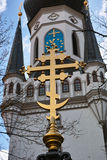 Guld- symbol på det kyrkliga tornet Royaltyfria Bilder