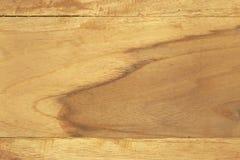 Guld- teakträbakgrundstextur Arkivfoto