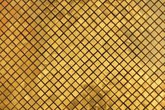 guld- tegelplatta för bakgrund Arkivbilder