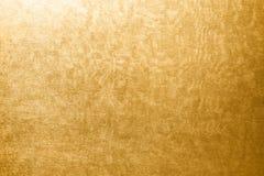 Guld- textur med störning Arkivfoton