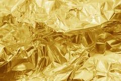 Guld- texturbakgrund Arkivbild