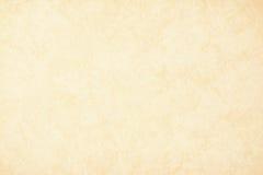 Guld- texturbakgrundspapper i gul tappningkräm eller beige färg, pergamentpapper, abstrakt pastellfärgad guld- lutning Arkivfoton