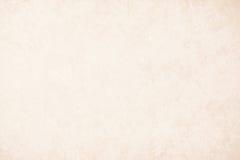 Guld- texturbakgrundspapper i gul tappningkräm eller beige färg, pergamentpapper, abstrakt pastellfärgad guld- lutning arkivfoto