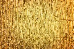 Guld- texturerad bakgrund för folie abstrakt begrepp Arkivfoto