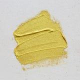 Guld texturerad målningslaglängd på kanfas royaltyfri fotografi
