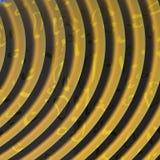 Guld texturerad spiral Arkivfoto