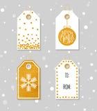 Guld texturerade festliga gåvaetiketter Arkivfoton