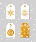 Guld texturerade festliga gåvaetiketter Royaltyfri Foto