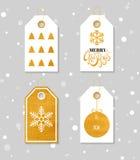 Guld texturerade festliga gåvaetiketter Royaltyfri Bild