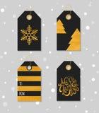 Guld texturerade festliga gåvaetiketter Arkivbild