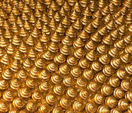 guld- texturerade twists för bakgrund Arkivfoton