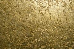 Guld- texturerat dekorativt murbrukslut upp arkivfoto