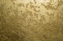 Guld- texturerat dekorativt murbrukslut upp royaltyfria foton