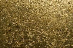 Guld- texturerat dekorativt murbrukslut upp royaltyfri foto