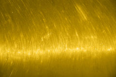 Guld- texturvägg Skrapad bakgrund för gul guld med en signalljus horisontellt Royaltyfri Fotografi